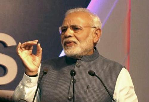 Prime Minister Narendra Modi reaches Surat